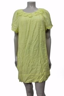 BCBGMAXAZRIA short dress Yellow Short Sleeve Shift Flower Detail At Neckline on Tradesy
