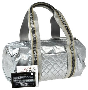Chanel Silver Travel Bag