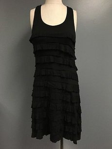 Charlotte Tarantola short dress Black Sleeveless Scoop Neck Ruffle Detail Sma7905 on Tradesy