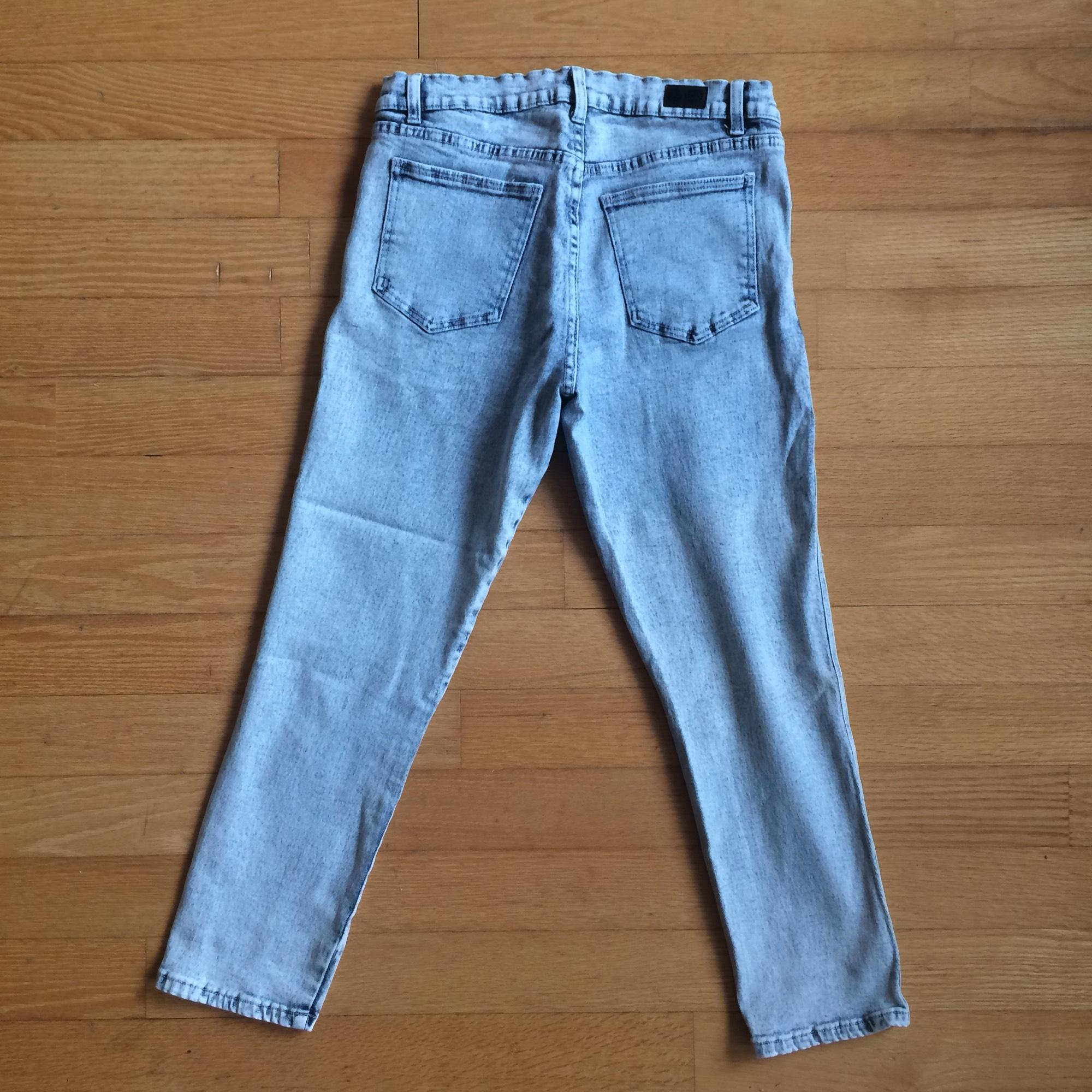 Brand new never been worn cheap Monday skinny stone wash blue jeans. From a smoke and pet free home.