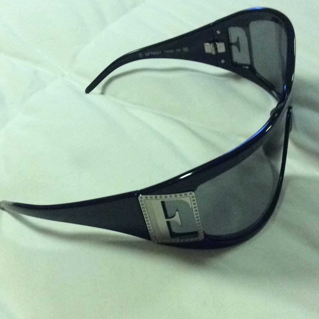 Italia Roth black with silver tone f sides glasses themselves are black but not really tradesy