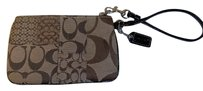 Coach Fabric Leather Trim Wristlet in brown and tan