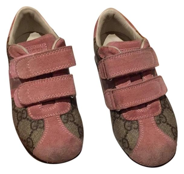 pink and brown athletic shoes on tradesy