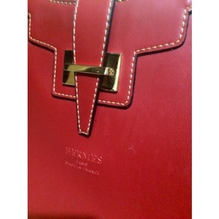 Hermes leather hobo purse. Red/Burgandy, no signs of use. It has HERMES imprint on outside but not inside. Hobo Bag
