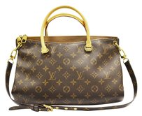 Louis Vuitton Canvas Zip Top Closure Tote in Brown