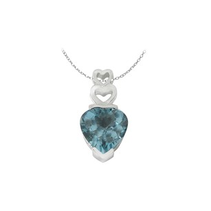 LoveBrightJewelry December Birthstone Blue Topaz Sterling Silver Rhodium Treated Heart Pendant