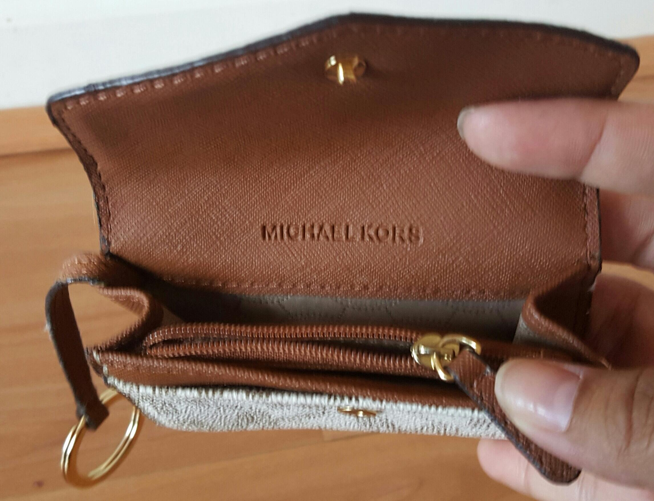 140599063bb0 ... gold tone jet set continental multifunction phone wallet 92541 c06dc  canada michael kors creme block logo mini wallet with key chain.