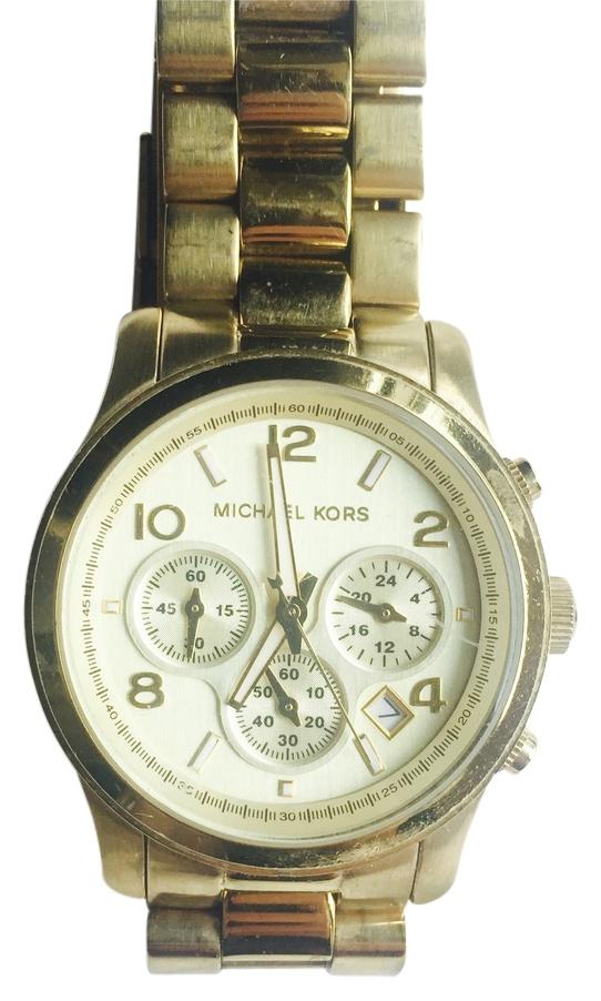 Michael Kors MK Michael Kors MK Review | Customer Reviews | Check Prices. Make a bold statement by accessorizing with the MK This all-black chronograph watch features an ion-plated stainless steel case and link bracelet, which is fastened securely with a push-button fold-over clasp.