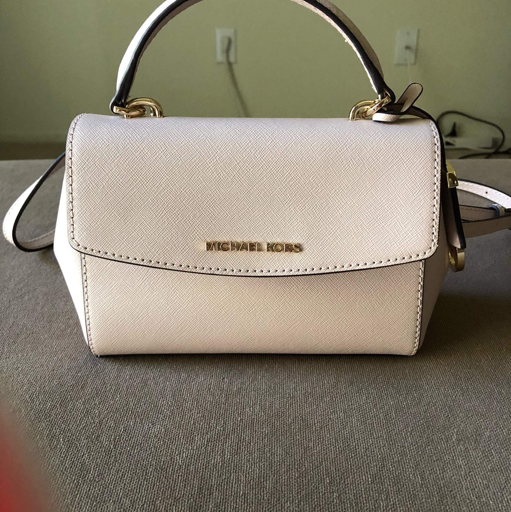 0cd18bc987a5 ... best price michael kors mk ava xsmall soft baby pink saffiano leather  cross body bag sale