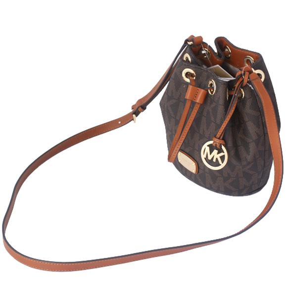 b109eed38ceb ... get michael kors mini jules drawstring brown signature pvc cross body bag  tradesy 4eb48 71543