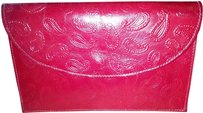 Hand-tooled red leather clutch