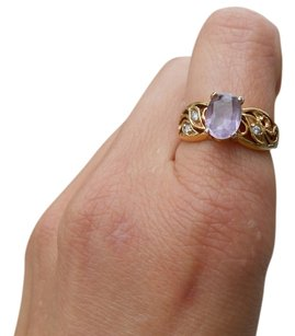 Palladium Purple Amethyst with five Dimond chips set in yellow gold