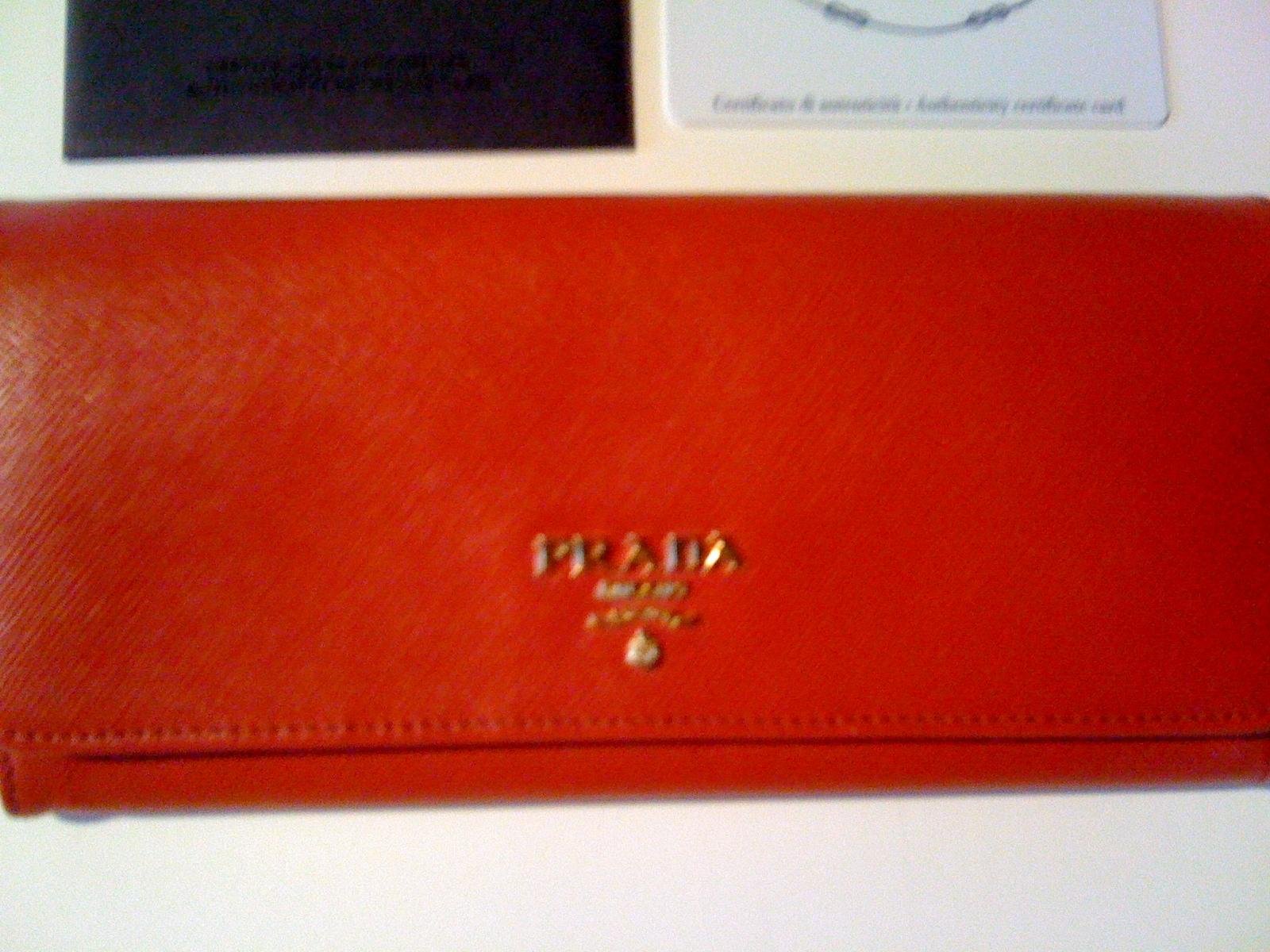 f7e222d8d755 ... germany prada saffiano flap wallet red 6db83 97fb4