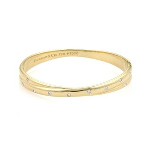 Tiffany & Co. Tiffany Co. Etoile Diamonds 18k Ygold Platinum Crossover Bangle Bracelet