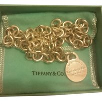 Tiffany & Co. Link chain and Return to Tiffany round tag charm in sterling silver