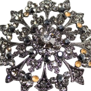 Unknown Designer Gray Gunmetal Tone Crystal Inlay Starburst Brooch