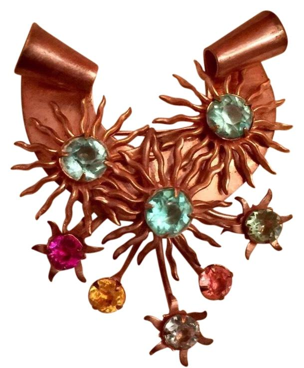 With vintage brooch